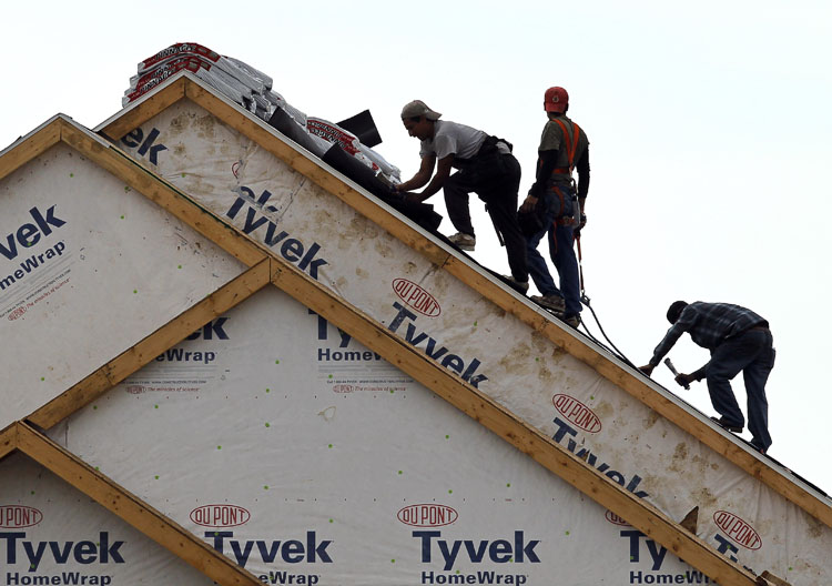 Workers install a roof at a new home construction site in West Des Moines, Iowa, recently. Sales of new homes had their second-worst month on record in August, signaling that the housing market remains a severe weak spot for the economy.