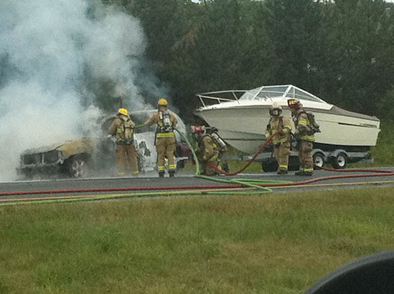 Firefighters extinguish car fire on northbound I-295 in Freeport.