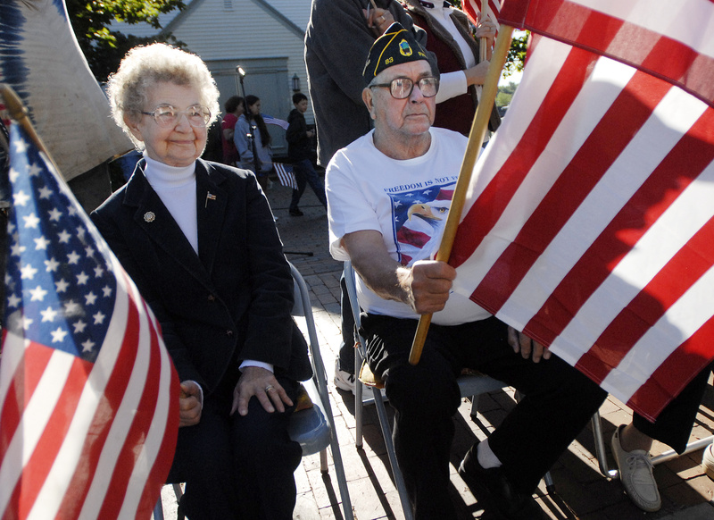Josephine and Roland Goss of Pownal wave flags along Main St. in Freeport along with the Freeport Flag Ladies and others who joined them for their 9th annual 9-11 tribute today. Roland Goss is a veteran and commander of American Legion Post 83.