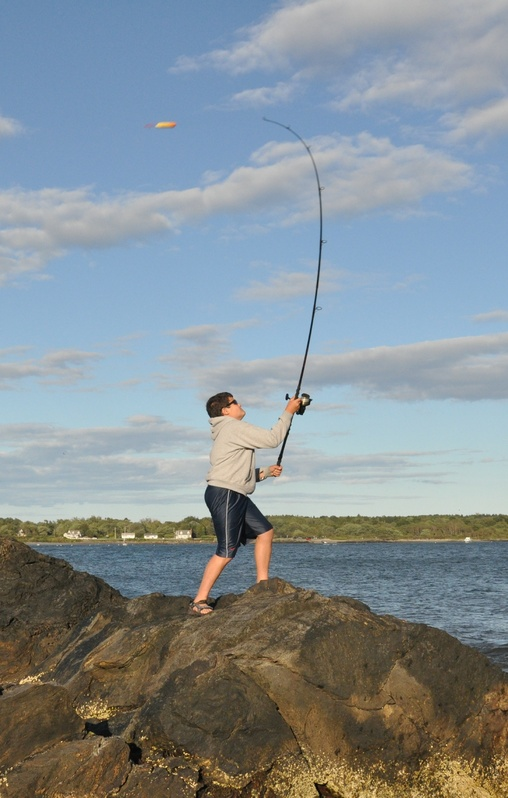 Surf-casting from quieter coastal spots in September is an ideal way to fish for migrating striped bass and bluefish.