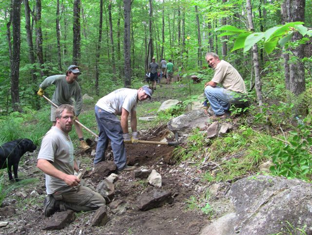 Volunteers with the Carrabassett Region chapter of the New England Mountain Biking Association work on a trail on Aug. 21. Mountain biking clubs in Maine have been busy building and opening trails.