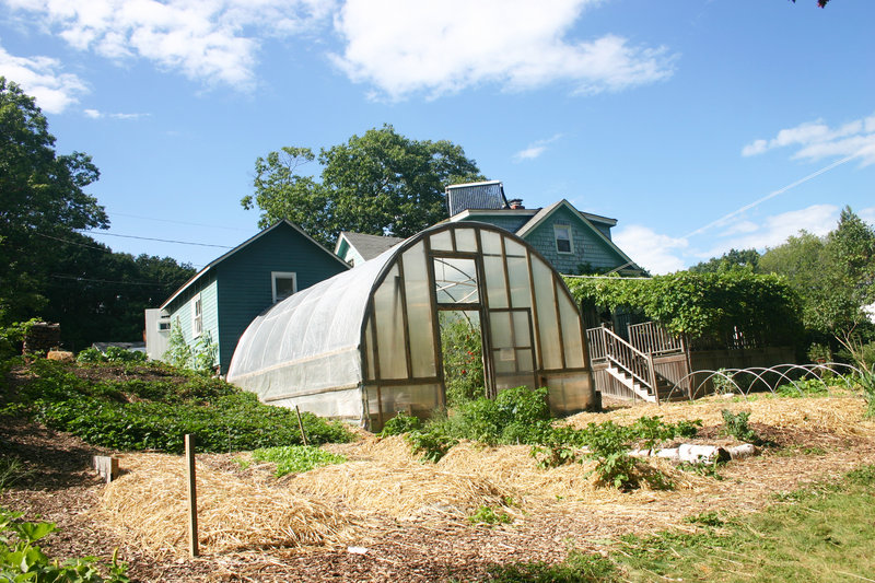 The greenhouse, strawberry patch, grape arbor and some of the annual beds sit behind the Fernandes-Whitten house.