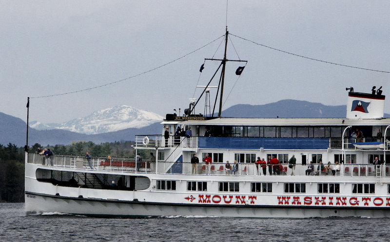 The excursion vessel SS Mount Washington cruises across Lake Winnipesaukee near Laconia, N.H., with a snow-covered Mount Washington itself in the background in this May 1, 2006, file photo. Readers discuss the question of whether Maine or the Granite State offers the best economic climate.
