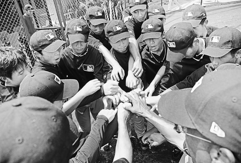 Players gather at a training camp in Wuxi, China. Major League Baseball is targeting teens in hopes of grooming potential talent and ultimately increasing the sport's popularity in the most populous country.
