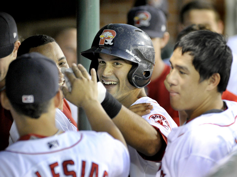 Will Vazquez of the Portland Sea Dogs is welcomed by teammates Tuesday night after hitting a home run during a 6-0 victory against the Binghamton Mets at Hadlock Field.