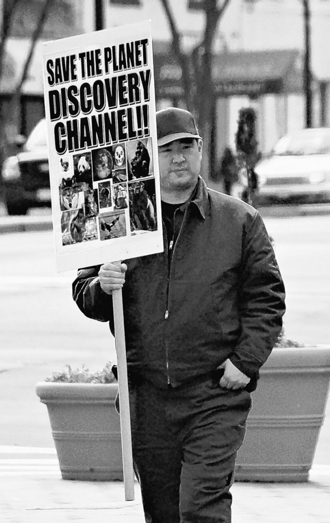 In this photo from Feb. 14, 2008, James J. Lee holds a protest sign in front of the headquarters of the Discovery Channel networks in Silver Spring, Md.
