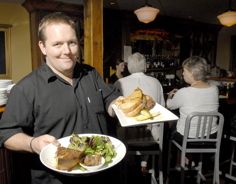 Old Vines Wine Bar owner Mike Farrell with a quiche special and a meatloaf panini.