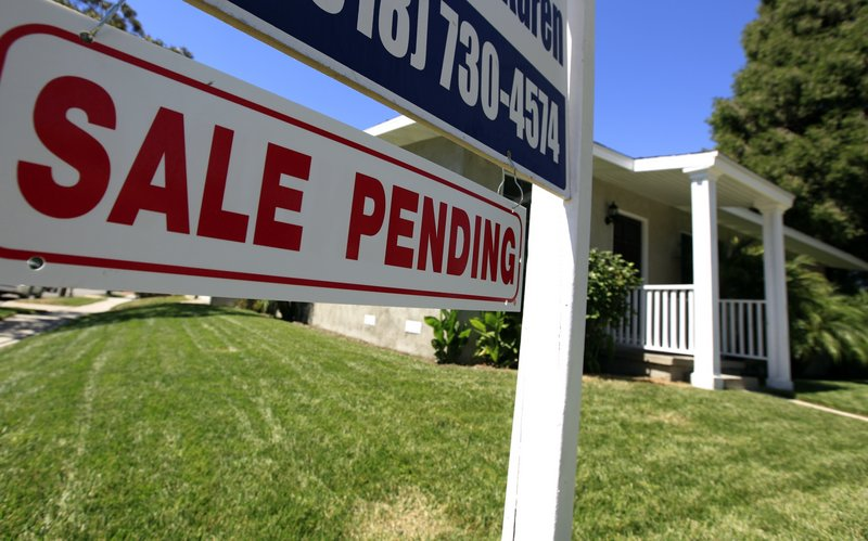 Sales of new and previously owned homes fell to a record low in July, despite the falling mortgage rates.
