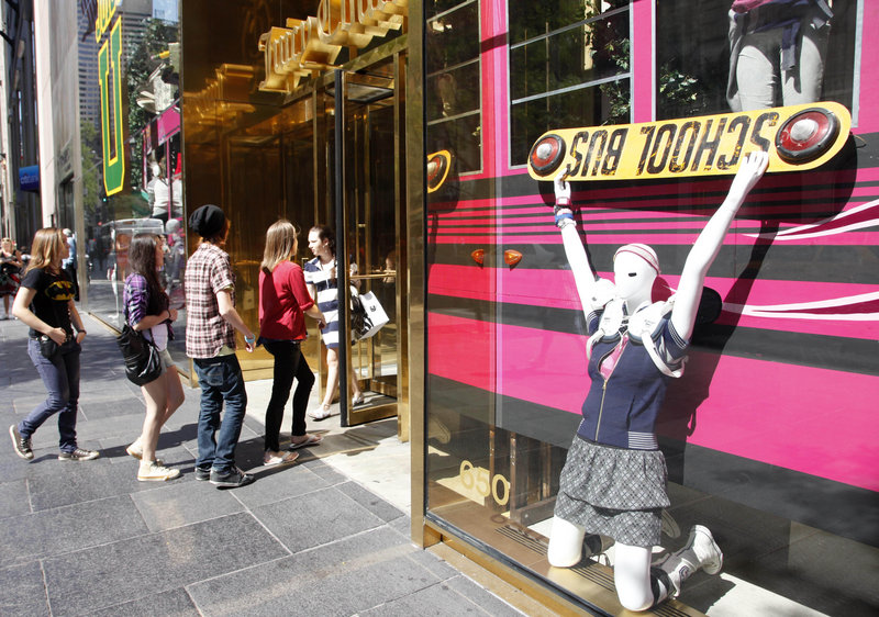 Teenagers enter a Juicy Couture store in New York City. Retailers report gains for August, helped by students' shopping.