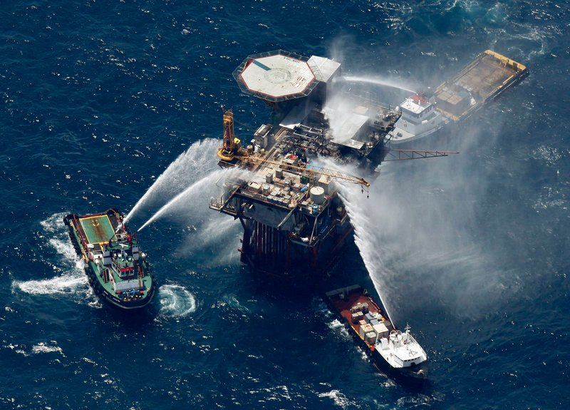 Boats spray water on a Mariner Energy oil and gas platform on Thursday in the Gulf of Mexico after a fire broke out on it. All 13 platform crew members were rescued.