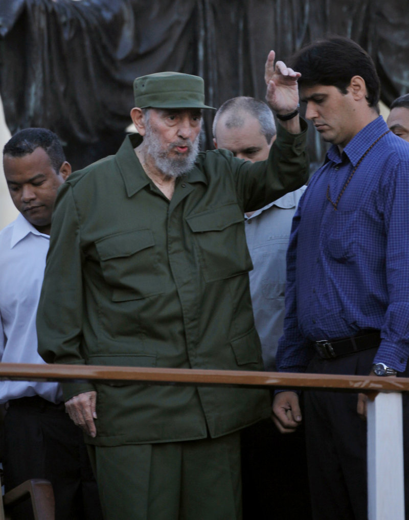 Fidel Castro greets students before his speech outside the University of Havana last week. Cuba's ex-president has steered clear of local issues in recent years.