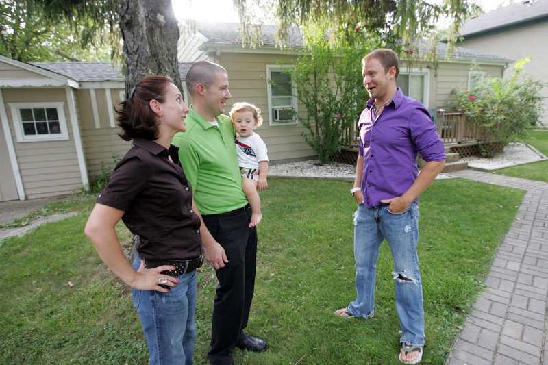 "Cyndee and Jason Pote, holding their son Cooper, talk with Matthew Miles, who rented their home in Southfield, Mich. ""We were able to cover our mortgage and then some,"" she said."