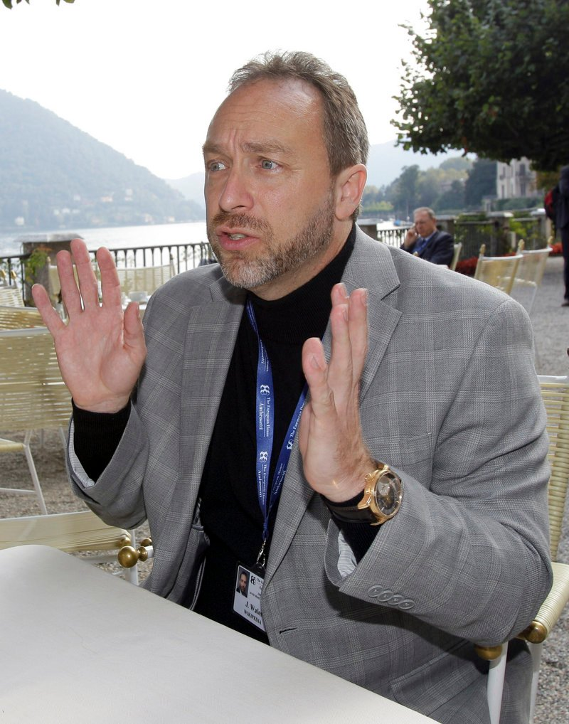 "Jimmy Wales, founder of the nonprofit Wikipedia, is optimistic that people will pay for news through dedicated apps. ""If I just click on my iPad, and it's billed on my normal bill, that micropayment model makes it possible for people to have an impulse purchase,"" he said while attending a conference in Cernobbio, Italy."