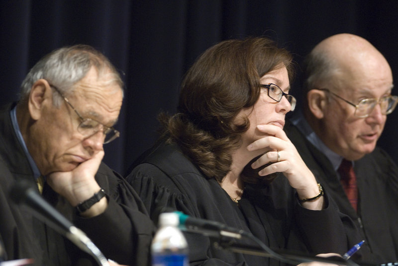 Maine Supreme Court justices hear arguments during a public session for students at Falmouth High School in 2007. From left are Justice Robert Clifford, Chief Justice Leigh Saufley, and Justice Donald Alexander.