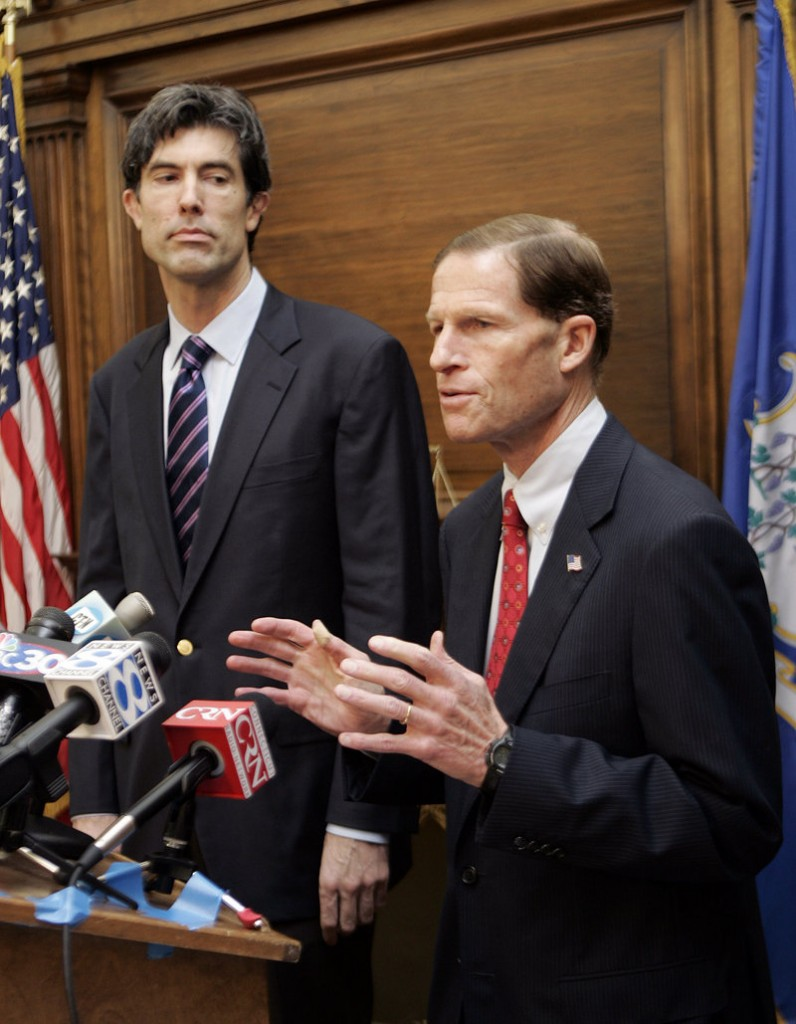 Jim Buckmaster, CEO of Craigslist, left, watches as Connecticut Attorney General Richard Blumenthal speaks at a news conference in Hartford in 2008. Blumenthal said Saturday he welcomed Craigslist's move to shut down its adult services section. It's unclear if the closure is permanent.