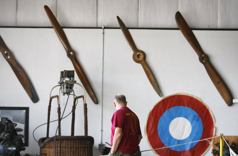 Glenn Snow of Marshfield, Mass., walks by a display of antique propellers while visiting the Vintage Motorcycle Meet and Antique Aeroplane Show at the Owls Head Transportation Museum in Owls Head on Saturday. Snow, who was on his way to Seboeis for the weekend, says the transportation museum is a