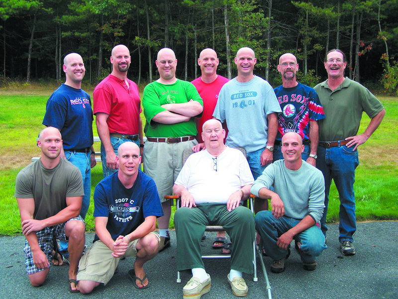 Russell Cotnoir Sr. is surrounded by sons and grandsons who shaved their heads last month in East Winthrop. One son, Chris, at back right, kept his hair because he's growing it out for a donation to Locks of Love. He shaved his beard instead.