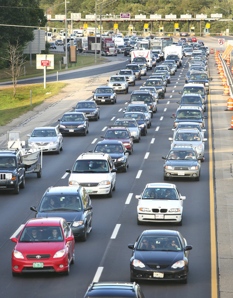 Motorists inch along southbound after going through the York tollbooth late Monday afternoon. Traffic headed south at the rate of 3,700 cars per hour from 11 a.m. to 6 p.m.