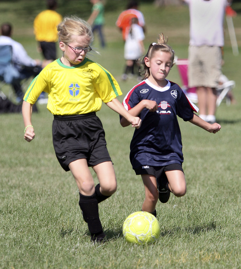 Mary Jerome of Brazil, left, tries to get a step on Hannah Collum of USA during their U10 girls match. U10s play 6 vs. 6 with goalkeepers.