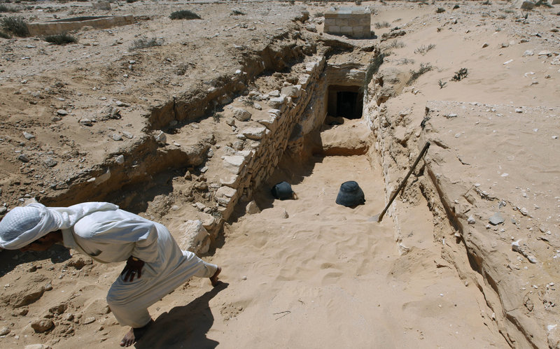 An Egyptian laborer works at the entrance of a tomb under restoration at the ancient city of Leukaspis, a well known Greco-Roman port overlooking the Mediterranean Sea at the costal resort of Marina, Egypt on Sunday. Ancient tombs were discovered by road engineers in 1986.