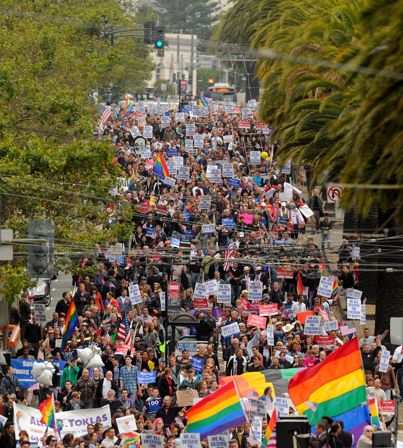 Same-sex marriage supporters march in San Francisco on Aug. 4 celebrating a federal judge's decision overturning California's Proposition 8.