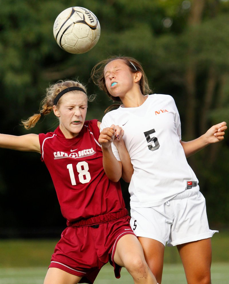 Hannah Twombly of North Yarmouth Academy, right, wins the ball against Madelaine Riker of Cape Elizabeth during their schoolgirl soccer game Tuesday. Cape Elizabeth improved to 2-0 with a 5-0 victory.