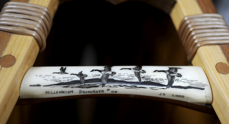 A piece of moose antler with geese carvings by Jerry Stelmok serves as a handle on his limited edition Millennium Sojourner wooden canoe.