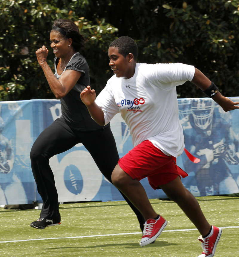 First lady Michelle Obama runs a 40-yard sprint Wednesday in New Orleans, as she participates in the Let's Move! Campaign and the NFL's Play 60 clinic with area youth – programs designed to promote exercise and fight childhood obesity. The first lady also appeared at an elementary school to promote a new phase of her anti-obesity program, which will focus on nutrition.