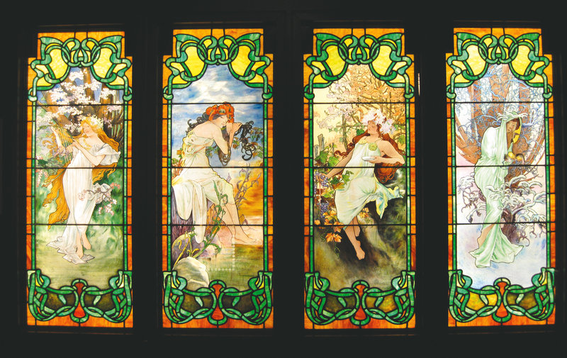 Czech nouveau artist Alphonse Mucha or one of his followers may have crafted these painted-glass panels representing the four seasons at the Smith Museum.