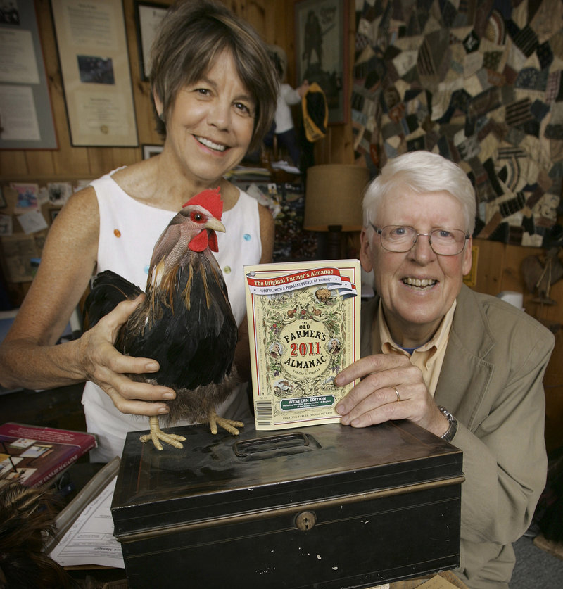 Editor Janice Stillman, left, and editor-in-chief Jud Hale pose in Dublin, N.H., with the 2011 edition of the Old Farmer's Almanac. It has been published for 219 years.
