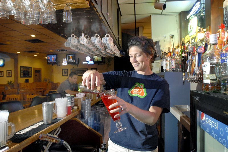 Pat's Pizza bartender Alicia Frechette mixes a drink at the Pat's North Windham location, which has at least 40 TVs for sports enthusiasts.