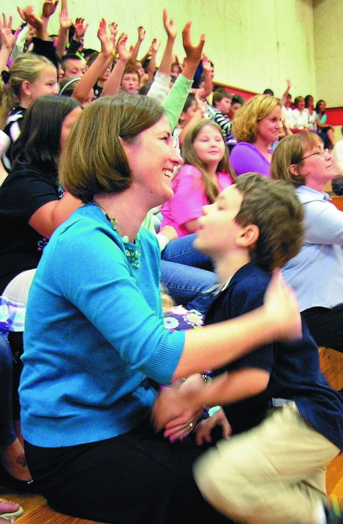 Shelly Moody, who teaches at Williams Elementary School in Oakland, holds onto her son, Jacob, 5, Friday morning as she is announced as the 2011 Maine Teacher of the Year. Last year's winner was Kevin Grover of Falmouth.