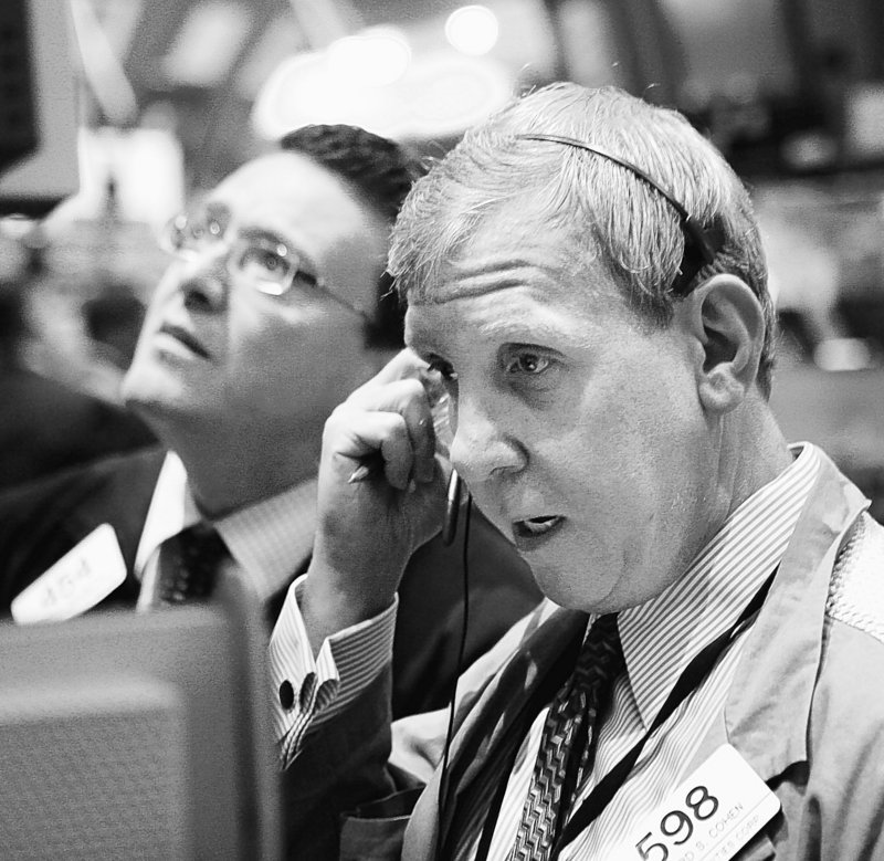 Traders and specialists work on the floor of the New York Stock Exchange earlier this month.