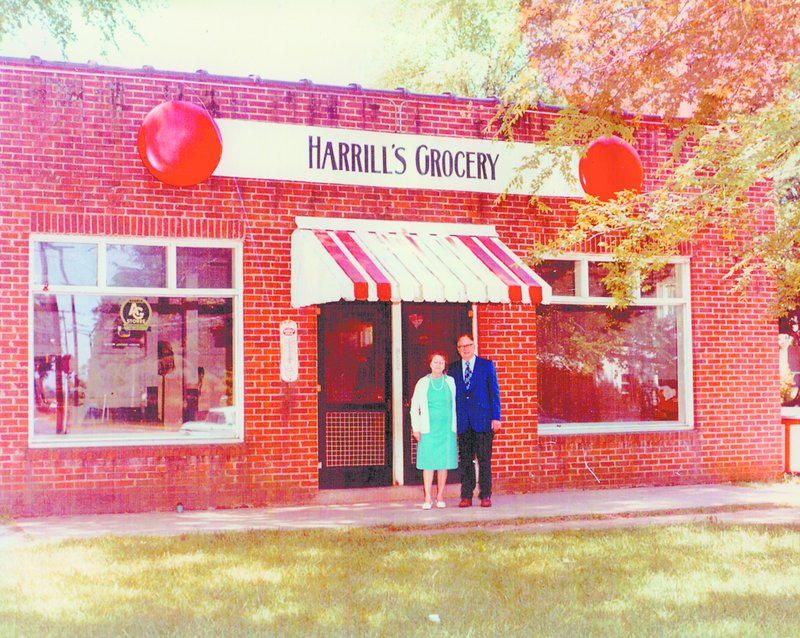 Libby Harrill Mitchell's parents, Lula Mae and Charlie, pose in front of Harrill's Grocery, the family store, in this undated photo provided by Libby's sister, Joyce Childers of Gaffney.