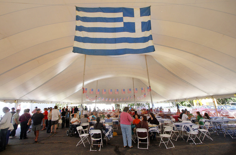 The Greek flag hangs in the festival tent.