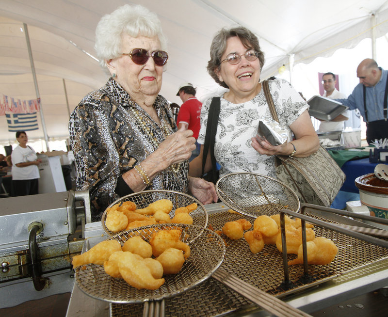 June Dupont, left, and Donna Gagnon order some loukoumades.
