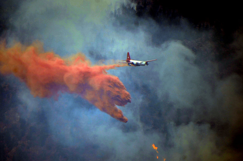 An aircraft drops fire retardant ahead of flames near Sunshine Canyon, in Boulder County, Colo., on Sept. 7.
