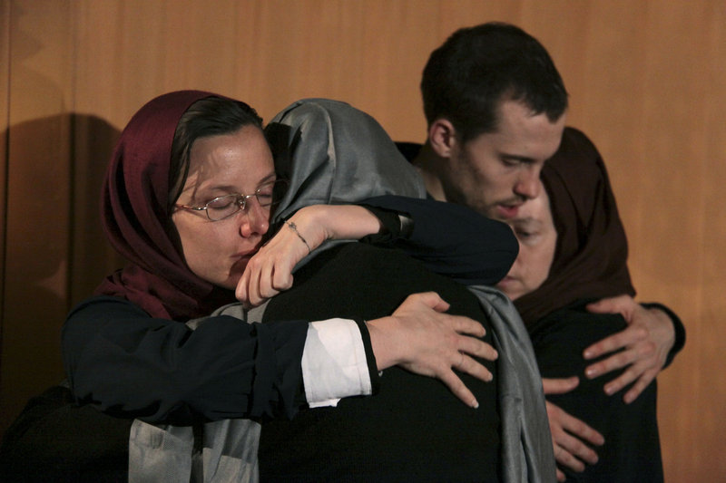 Sarah Shourd, left, hugs her mother, Nora Shourd, as Shane Bauer, second right, hugs his mother, Cindy Hickey, during their meeting at the Esteghlal Hotel in Tehran on May 21.