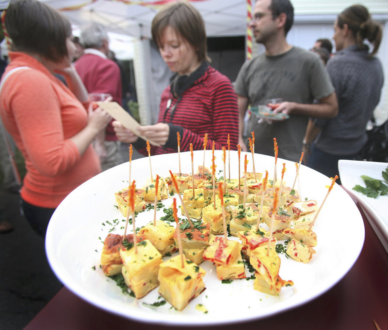 Pintxos de tortilla Espanola, a traditional Spanish omelet with fried potatoes.