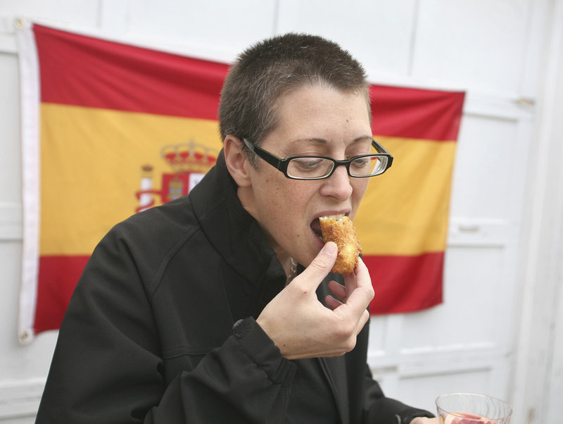 Lisa Panzeri of Portland samples the croquetas de pollo y Jamon Serrano – chicken and bechamel fritters with Serrano ham.