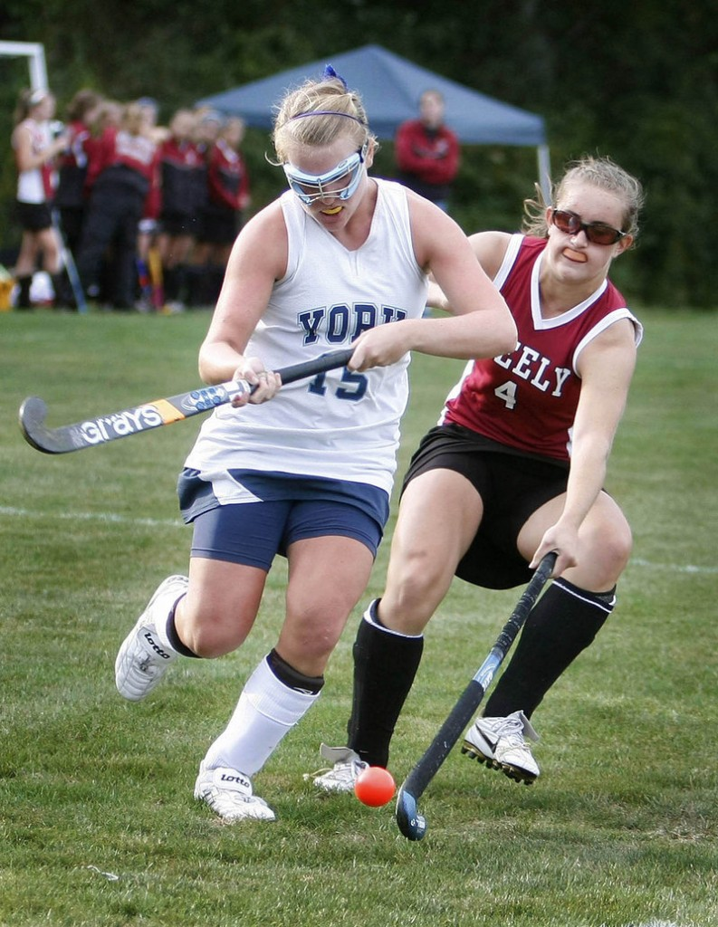 Emily Curato, right, of Greely knocks the ball away from Catie Keenan of York during their Western Maine Conference field hockey game Monday. York remained unbeaten with a 3-0 victory.