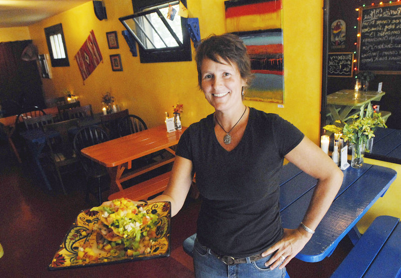 Tanya Dunn, a server at Blue Burrito Cafe in Westbrook, with a blackened baby shrimp tostada.