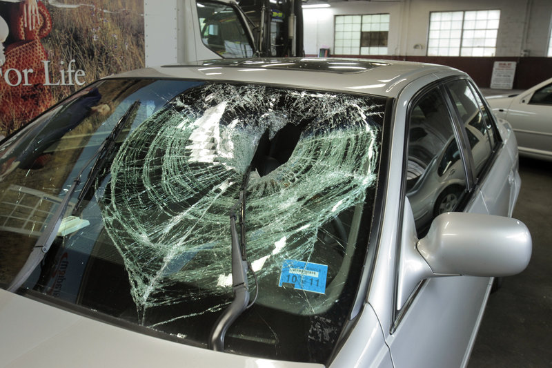 A football-sized rock dropped from the railroad bridge near St. John Street in Portland on Saturday hit the windshield of this 2002 Cadillac driven by Peter Brichetto.