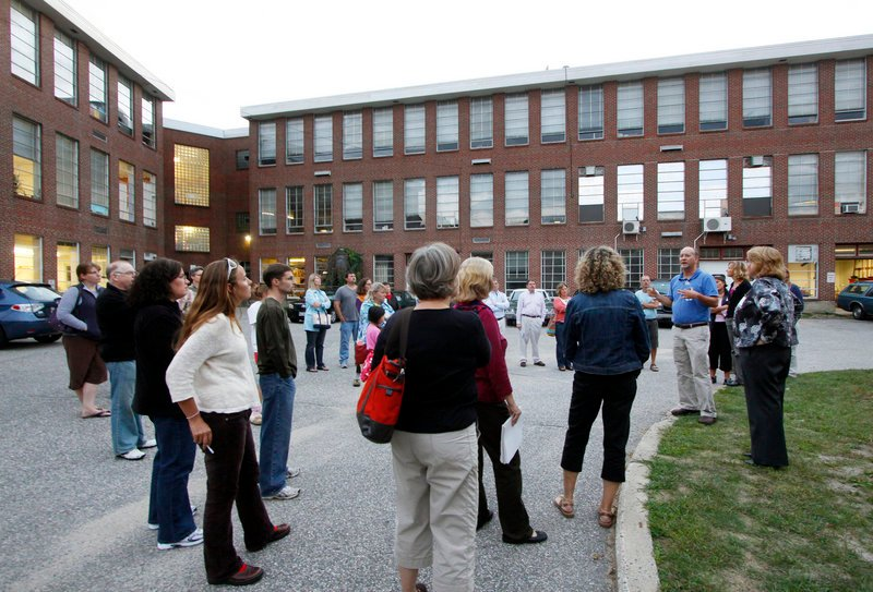 Tour participants listen to Scott Pakulski, an architectural designer with Harriman Associates, talk about the renovation plans for South Portland High School on Tuesday.