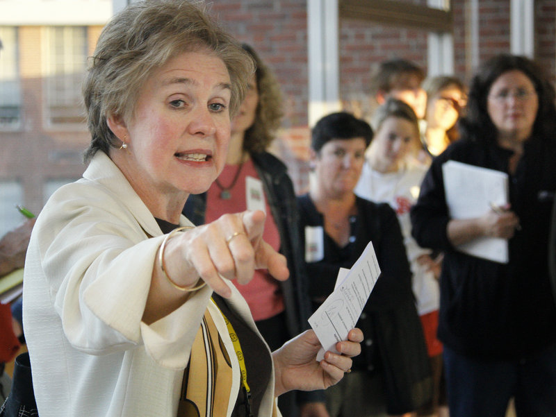 """South Portland High School Principal Jeanne Crocker points to areas of concern during a tour of the school Tuesday. """"It's a big, sprawling building,"""" she said. """"And security is an issue."""""""