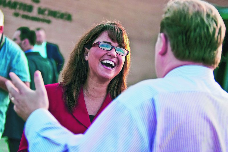 U.S. Senate candidate Christine O'Donnell talks to voters in Wilmington, Del., on Tuesday.