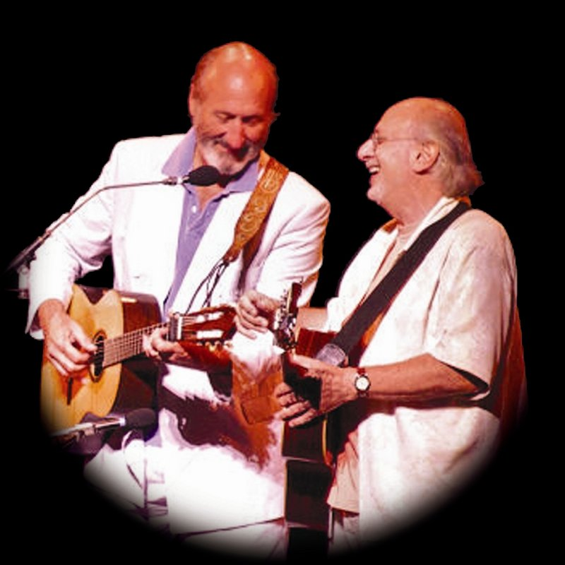 Noel Paul Stookey and Peter Yarrow perform at the University of Maine at Orono on Sunday.