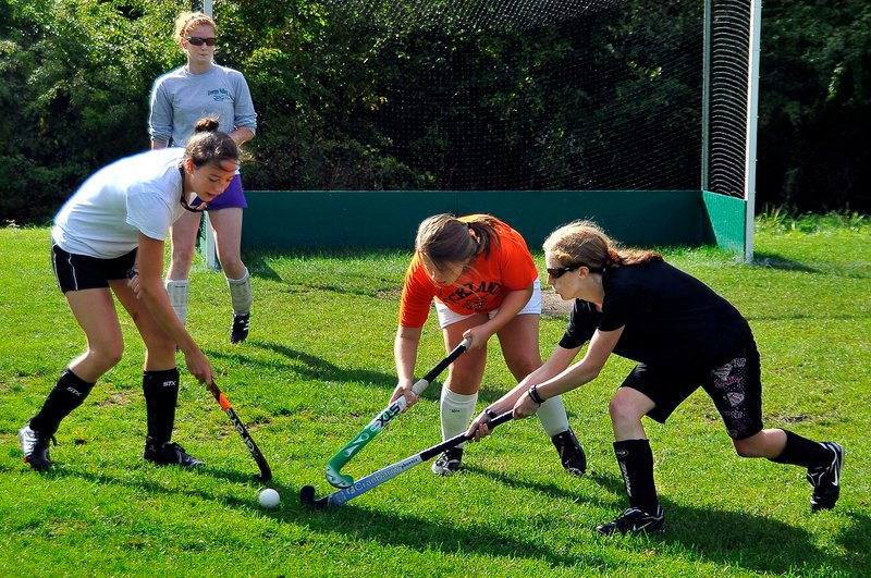 The Rockland and Georges Valley combined field hockey team has shown promise. At practice, Molly Meller of Georges Valley watches as Colleen Haskell of Georges Valley drills with Danielle Bedard, center, and Rachel Freeman of Rockland.