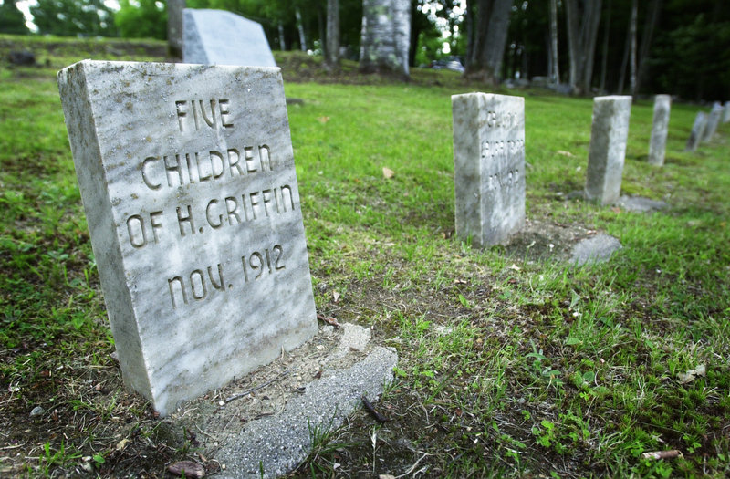 This stone marks a grave in the Pineland Farms cemetery with some of the bodies that were moved in 1912 from Malaga Island. State workers exhumed all 17 graves in Malaga's cemetery and reburied the remains among nine plots in the graveyard of the facility in Pownal.