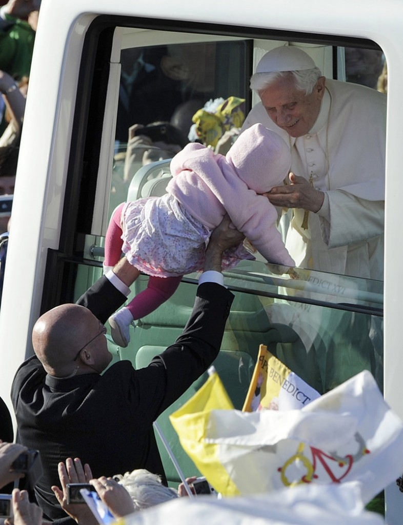 Pope Benedict XVI greets Maria Pyszczak as he arrives at Bellahouston Park in Glasgow, Scotland, on Thursday.